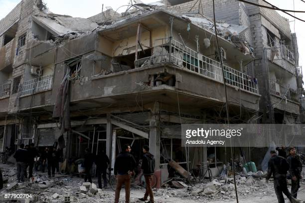 A damaged building is seen after Assad regime's warplane carried out airstrikes over Arbin town of the Eastern Ghouta region in Damascus Syria on...