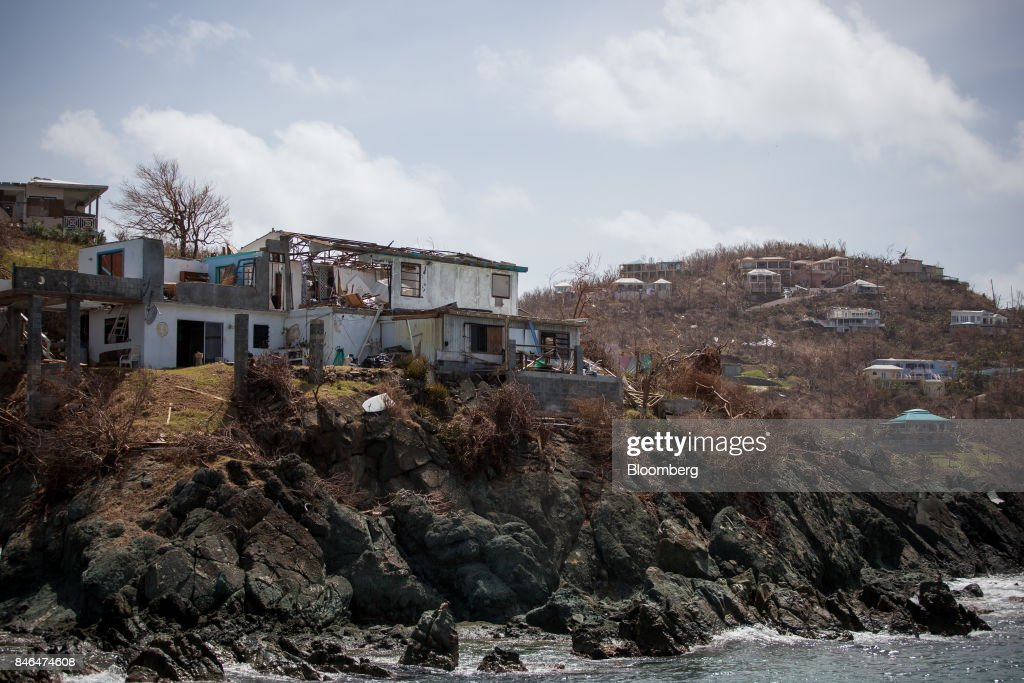 A damaged building is seen after Hurricane Irma in St John, U.S. Virgin Islands, on Tuesday, Sept. 12, 2017. After being struck by Irma last week, the U.S. Virgin Islands couldnt look less like a tourist destination. Many local residents are giving up and getting out after losing everything to the category 5 storm,even as the local authorities in the U.S. territory say they are determined to rebuild the islands. Photographer: Michael Nagle/Bloomberg via Getty Images
