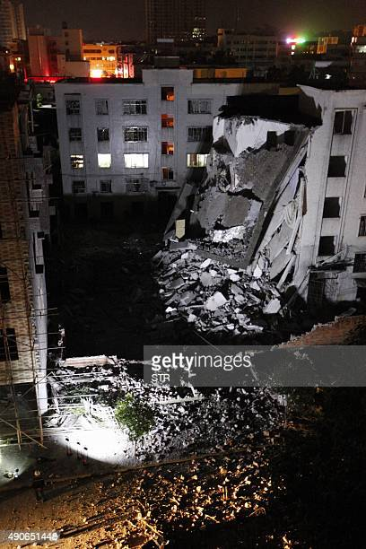 A damaged building is seen following blasts in Liucheng county in Liuzhou in south China's Guangxi province on September 30 2015 Three people were...