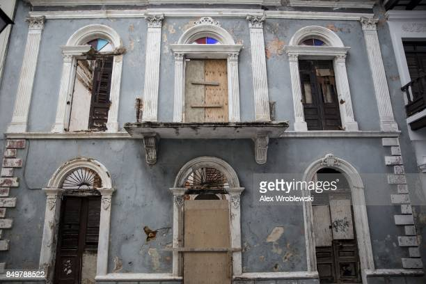 A damaged building stands in Old San Juan as residents prepare for a direct hit from Hurricane Maria on September 19 2017 in San Juan Puerto Rico...