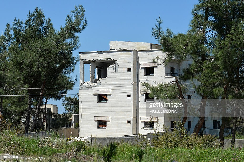 A damaged building stands in Salma in the coastal Syrian province of Latakia on April 26, 2013. The number of Syrians who have fled their conflict-ravaged homeland has surpassed 1.4 million, the United Nations refugee agency said, warning that it was no longer able to meet their medical needs.