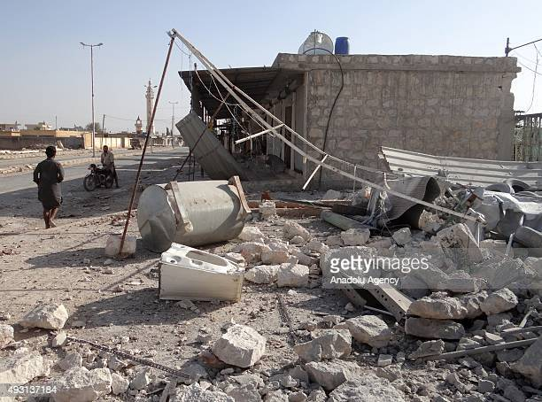 Damaged buildings are seen after the Russian war crafts hit the village of AlHader south of Aleppo Syria on October 18 2015