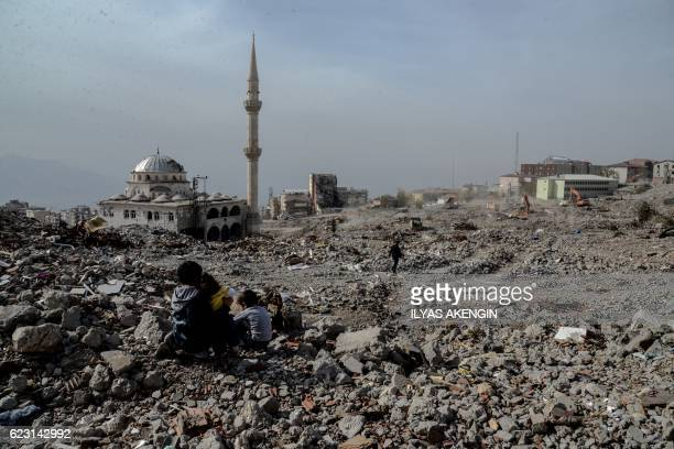 TOPSHOT Damaged buildings are seen on November 14 2016 in Sirnak after a 246day curfew was partially lifted The curfew in Sirnak a city of 290 was...