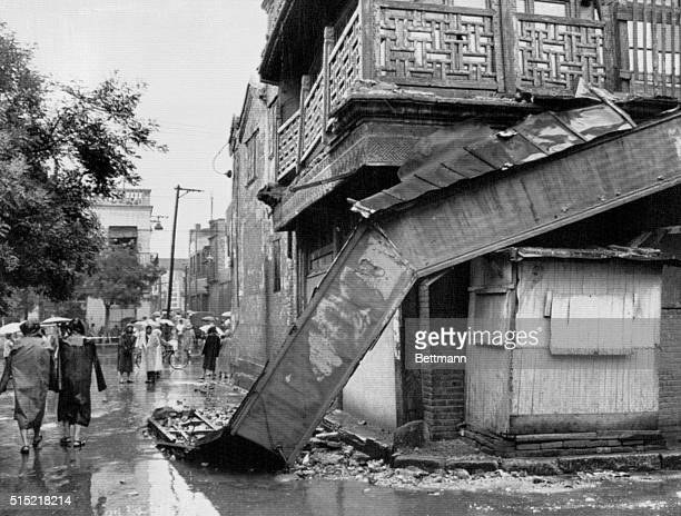 Damaged buildings in a popular shopping district in Beijing after the 1976 earthquake in Tangshan