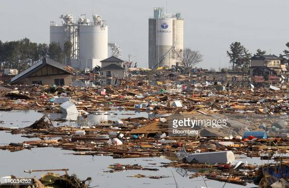 Damaged buildings sit amongst storm debris in Fukushima Japan on Sunday March 13 2011 Japan aims to compile a package to fund the rebuilding effort...