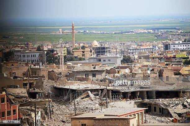 Damaged buldings are seen as Peshmerga forces and Daesh also known as ISIL battle in Sinjar town of Mosul on February 27 2015