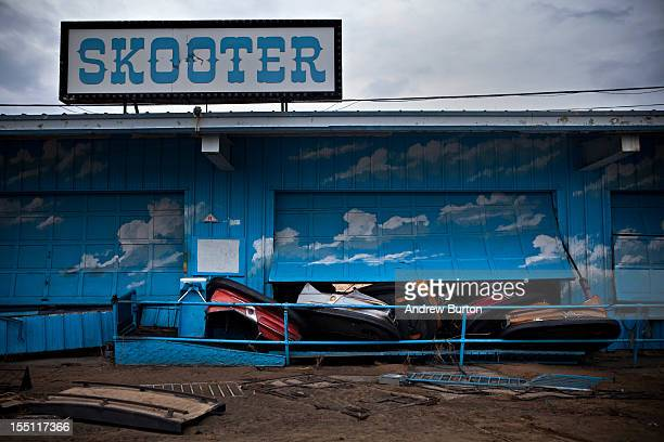 Damaged bumper cars poke through a garage door at the Keansburg Amusement Park after Superstorm Sandy swept across the region on November 1 2012 in...