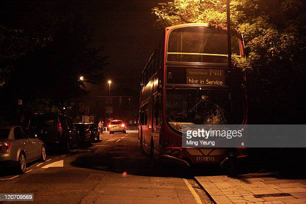 A damaged bus is seen on the streets of Ealing on August 8 2011 in London England Sporadic looting and clashes with police continue for a third day...