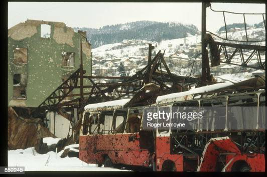 Damaged buses and buildings sit March 5 1996 in Sarajevo BosniaHerzegovina The city is reopening its businesses repairing damages from the war and...