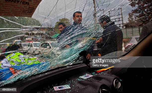 A damaged car hit by a tree branch is seen after a powerful earthquake struck northern Afghanistan with tremors felt as widely as Pakistan and...