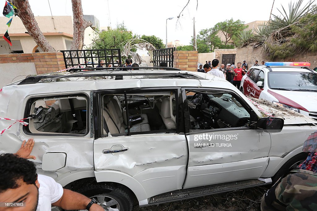 A damaged car is seen near the French embassy (unseen) in Tripoli following a car bomb attack, on April 23, 2013. A car bomb blasted the embassy of France in Tripoli, injuring two French guards and causing serious damage to the building, embassy and Libyan sources said. AFP PHOTO/MAHMUD TURKIA