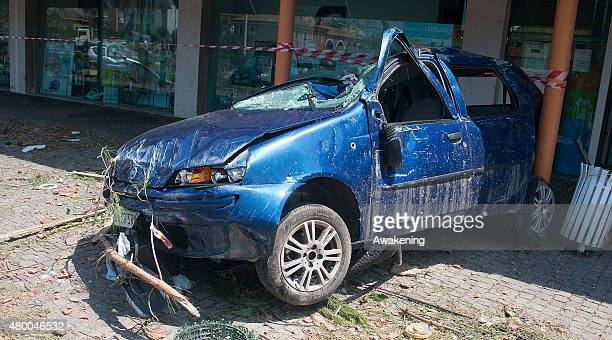 A damaged car rests into a shopping arcade after yesterday tornado on July 9 2015 in Venice Italy A tornado swept through the outskirts of Venice...