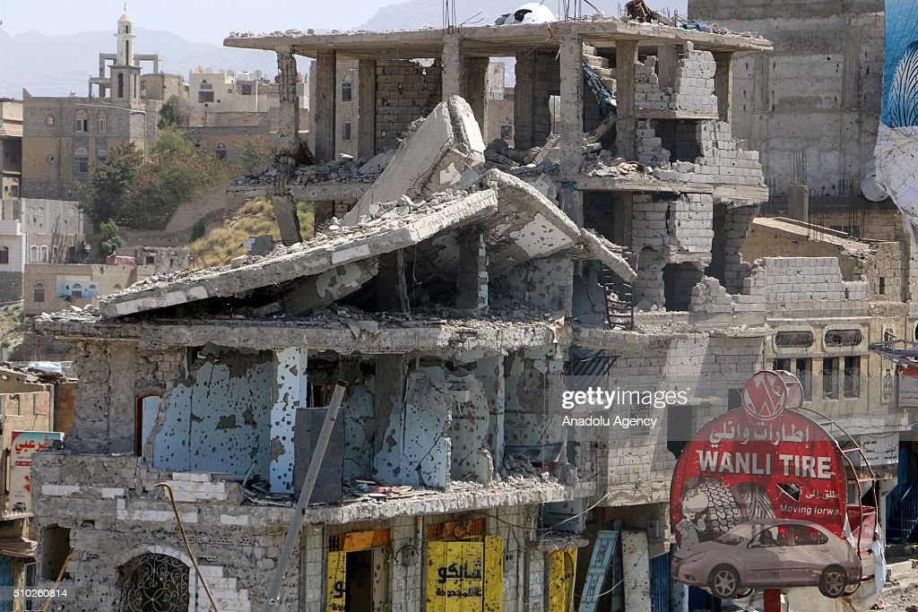 Damaged cars and buildings are seen after forces loyal to President of Yemen Abd Rabbuh Mansur Hadi captured Hasab neighborhood following clashes with Houthis and Yemen's former President, Ali Abdullah Saleh's forces, in Taiz, Yemen on February 14, 2016