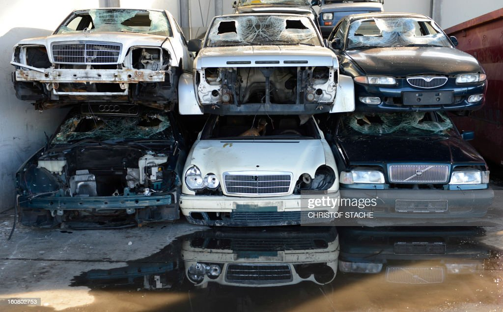 Damaged cars are pictured at a hall of a car recovery and recycling company near Munich, southern Germany, on February 6, 2013.