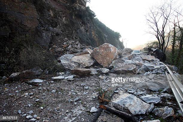 Damaged cars are pictured on Greece's main northsouth highway at Tempi Valley intersection following a major landslide on December 18 2009 Rockfalls...