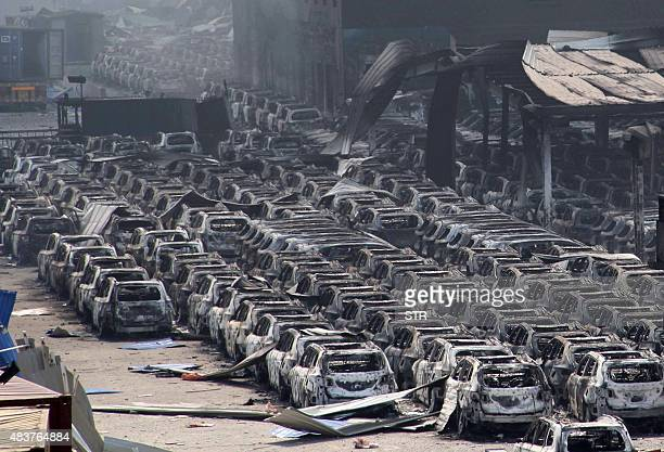 Damaged cars are seen at the site of a series of explosions in Tianjin on August 13 2015 A series of enormous explosions at an industrial area in the...