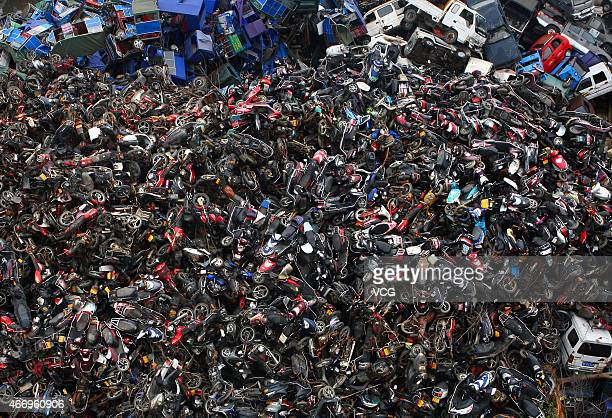 Damaged cars motor cycles and electric bicycles are seen stacked at a scrapyard on March 19 2015 in Hangzhou China China has a comprehensive...