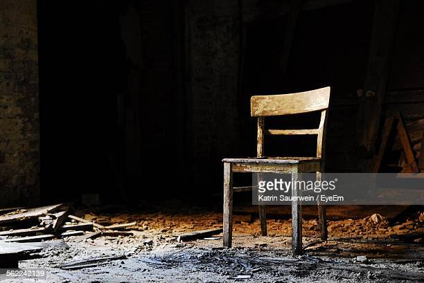 Damaged Chair In Abandoned Building