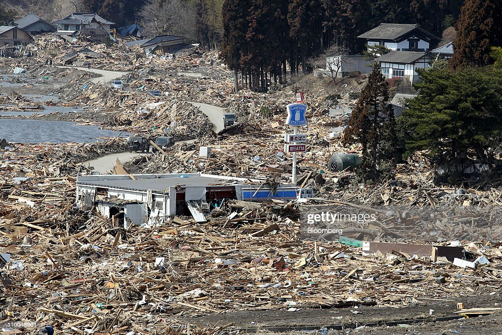 A damaged convenience store sits amongst buildings and tsunami debris in Rikuzentakada Iwate prefecture Japan on Monday March 14 2011 Workers battled...