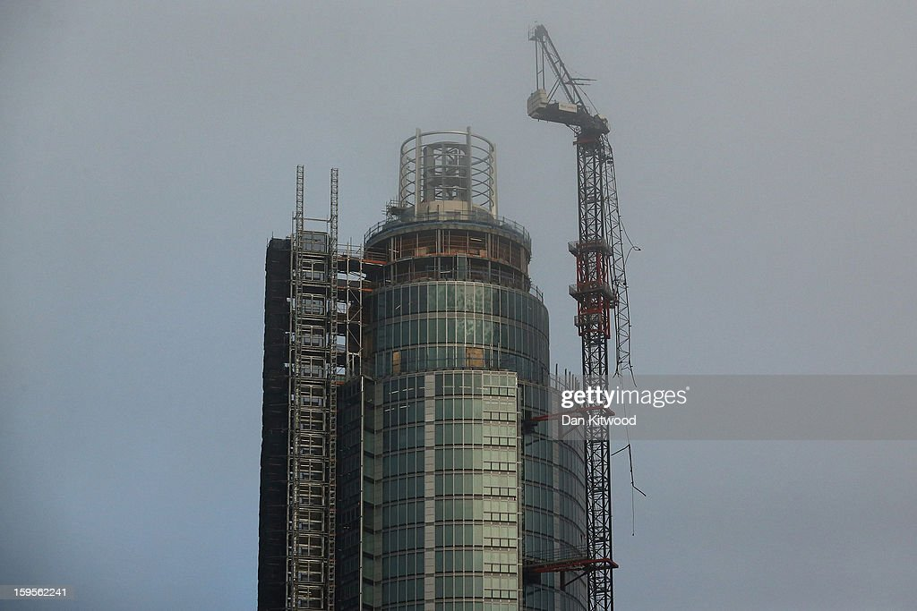 A damaged crane attached to St Georges Wharf Tower after a helicopter reportedly collided with it, in Vauxhall, on January 16, 2013 in London, England. According to reports, the helicopter hit the crane before plunging into the road below during the morning rush hour.