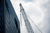 A damaged crane hangs over Madison Avenue following an accident May 31 2015 in New York City At least ten people were injured when a crane lifting a...