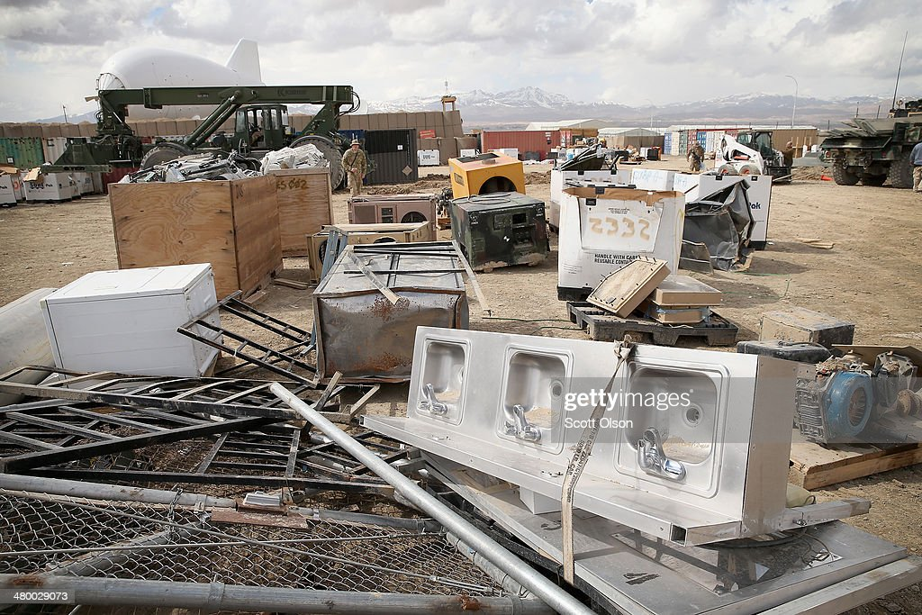 Damaged, destroyed and excess equipment and supplies left by departing units as the U.S. draws down manpower in the 13-year-old war sit in a retrograde yard before being sold for scrap at FOB Lightning on March 22, 2014 near Gardez, Afghanistan. In the past year the U.S. Military has been reducing troops and equipment in Afghanistan as it transitions from a role of combatants, fighting alongside Afghan soldiers, to assisting the Afghan National Security Forces in an advisory role. President Obama recently ordered the Pentagon to develop a contingency plan for a complete pullout from Afghanistan by the end of 2014 if Afghanistan President Hamid Karzai or his successor refuses to sign the Bilateral Security Agreement.