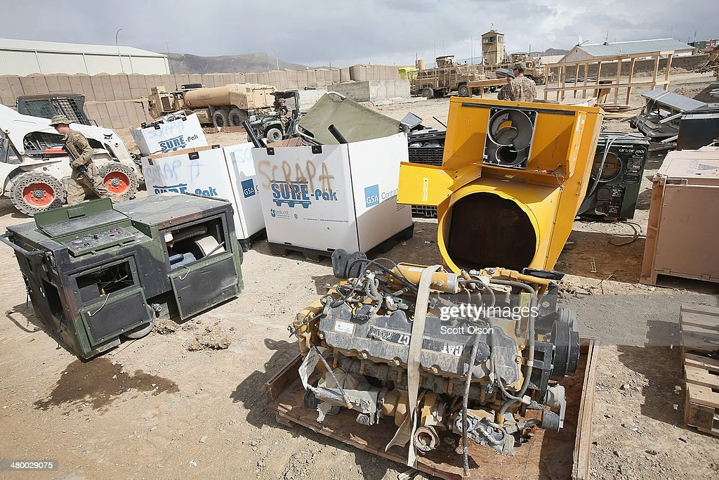 Damaged, destroyed and redundant equipment and supplies left by departing units as the U.S. draws down manpower in the 13-year-old war sit in a retrograde yard before being sold for scrap at FOB Lightning on March 22, 2014 near Gardez, Afghanistan. In the past year the U.S. Military has been reducing troops and equipment in Afghanistan as it transitions from a role of combatants, fighting alongside Afghan soldiers, to assisting the Afghan National Security Forces in an advisory role. President Obama recently ordered the Pentagon to develop a contingency plan for a complete pullout from Afghanistan by the end of 2014 if Afghanistan President Hamid Karzai or his successor refuses to sign the Bilateral Security Agreement.