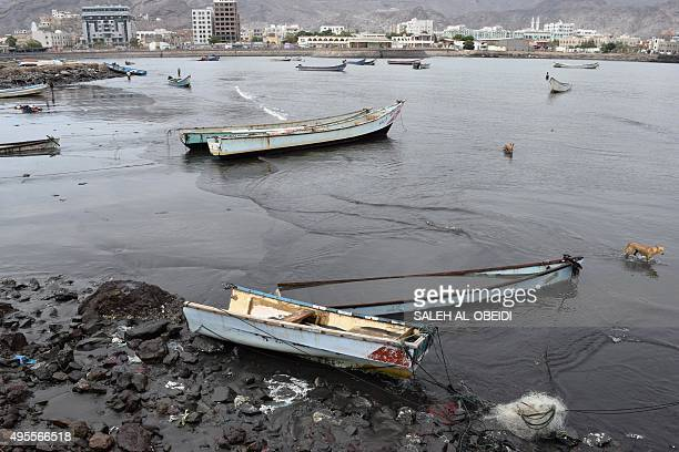 Damaged fishing boats are beached in the southern Yemeni port city of Aden on November 3 following a tropical cyclone that has slammed into the...