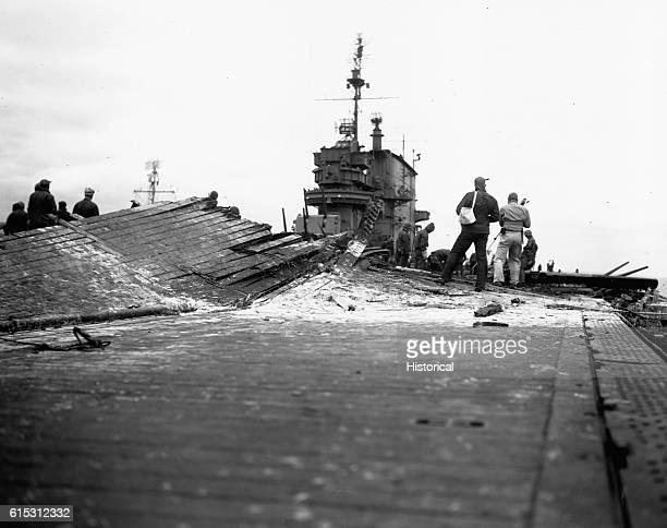 Damaged flight deck of the USS Saratoga a target of Japanese dive bombers off Iwo Jima ca 1945   Location near Iwo Jima Volcano Islands