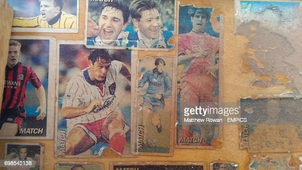 Damaged football stickers on a headboard to a bed from the 1993/94 season Including Alan Shearer Mark Bosnich Les Ferdinand Glenn Hoddle David Hirst...