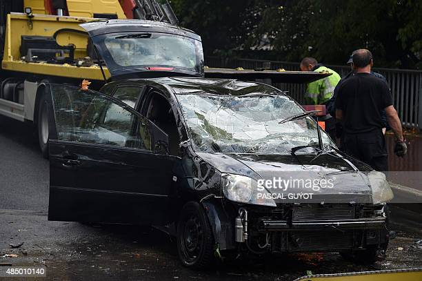 A damaged Ford Fiesta car in which two people died after the car was swept away by waters is loaded unto a truck in Montpellier on August 23 2015 Two...