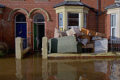 Damaged furniture is piled outside a house as rescue workers continue to evacuate people from their homes after Storm Desmond caused flooding on...