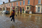 Damaged furniture is pilled outside a house as rescue workers continue to evacuate people from their homes after Storm Desmond caused flooding on...