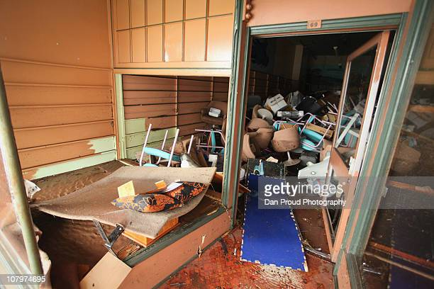 Damaged furniture is seen piled up in a store on January 11 2011 in Toowoomba Australia 8 people so far have been confirmed dead in towns in the...