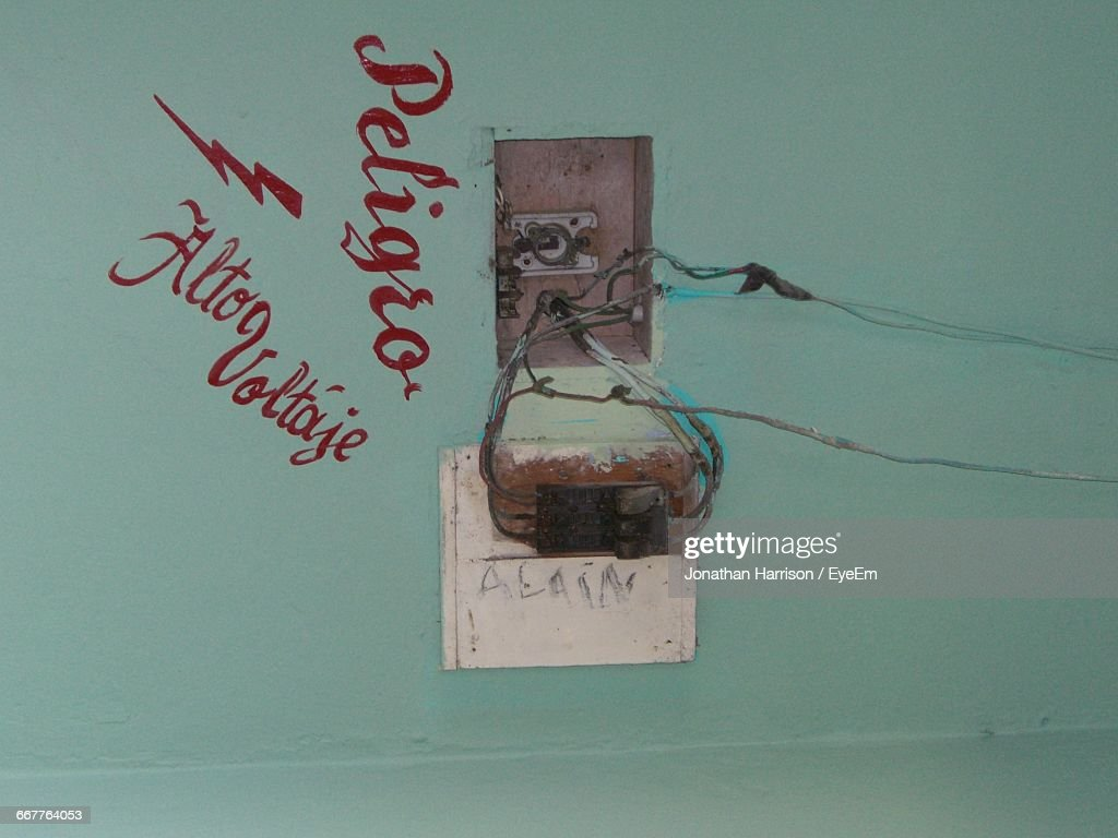 damaged fuse box and warning sign on wall picture id667764053?s=170667a sign on fuse box by building stock photo getty images fusebox sign in at fashall.co