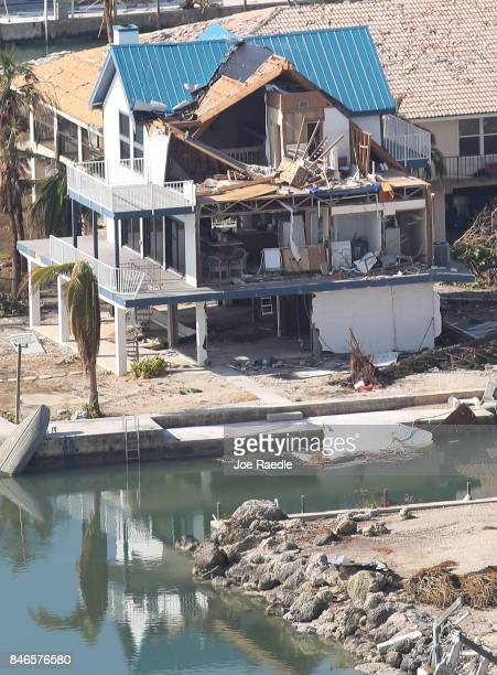A damaged home and streets littered with debris are seen after Hurricane Irma passed through the area on September 13 2017 in Ramrod Key Florida The...