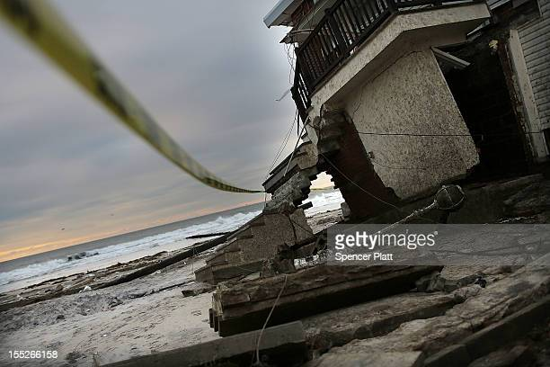 A damaged home is cordoned off along the beach in the Rockaway neighborhood in Queens where a large section of the iconic boardwalk was washed away...