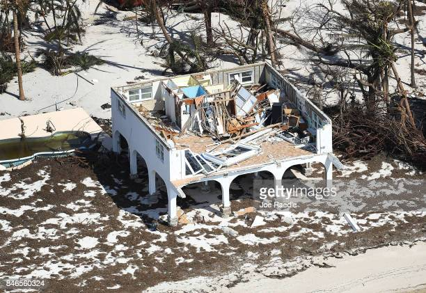 A damaged home is seen after Hurricane Irma passed through the area on September 13 2017 in Big Pine Key Florida The Florida Key's took the brunt of...