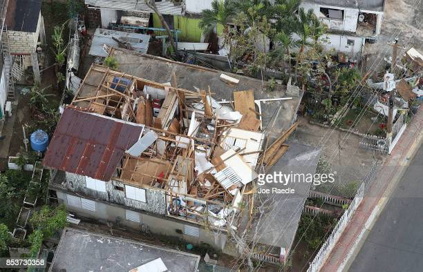 A damaged home is seen as people deal with the aftermath of Hurricane Maria on September 25 2017 in Levittown Puerto Rico Maria inflicted widespread...