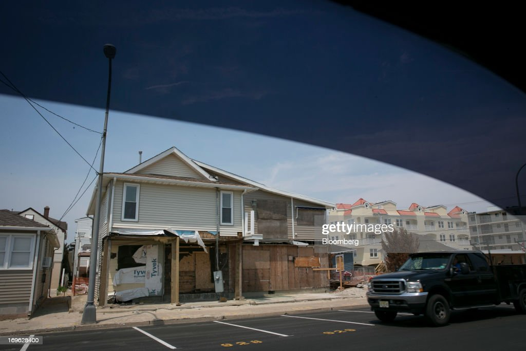A damaged home stands in Seaside Heights, New Jersey, U.S., on Wednesday, May 29, 2013. Sandy, which came ashore near Atlantic City, killed dozens of people and destroyed more than 365,000 homes in the state. Christie has said it will cost $36.9 billion for repairs and to prevent devastation from future storms. Photographer: Scott Eells/Bloomberg via Getty Images