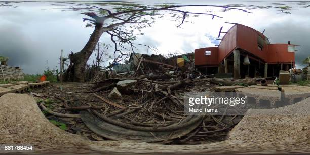 Damaged homes and debris stand in an area without electricity on October 15 2017 in San Isidro Puerto Rico Puerto Rico is suffering shortages of food...