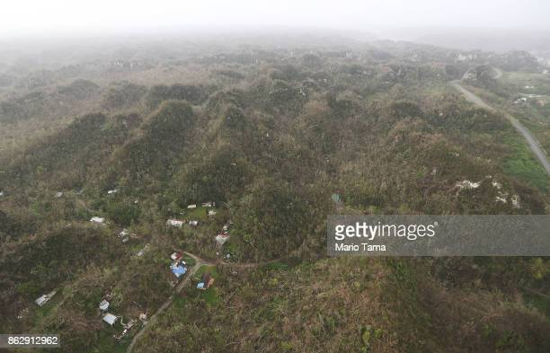 Damaged homes and structures are viewed from the air during recovery efforts four weeks after Hurricane Maria struck on October 18 2017 inflight over...