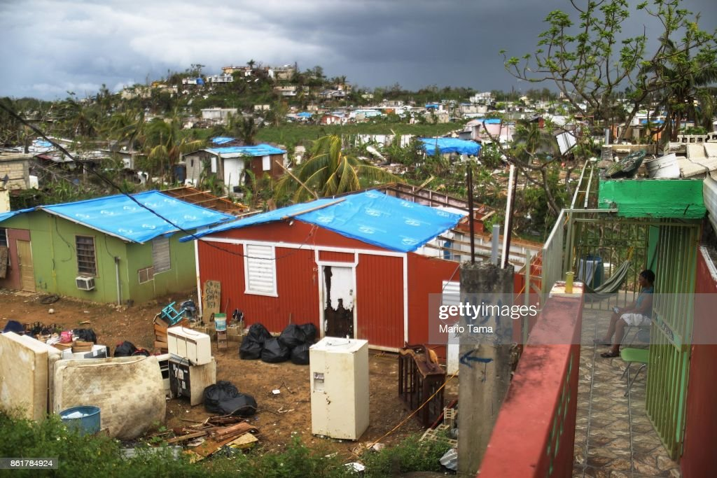 Damaged homes, some covered with tarps provided by an NGO, stand in an area without electricity on October 15, 2017 in San Isidro, Puerto Rico. Puerto Rico is suffering shortages of food and water in many areas and only 15 percent of grid electricity has been restored. Puerto Rico experienced widespread damage including most of the electrical, gas and water grid as well as agriculture after Hurricane Maria, a category 4 hurricane, swept through.