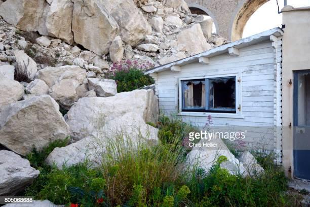 Damaged House After Landslide or Rock Fall