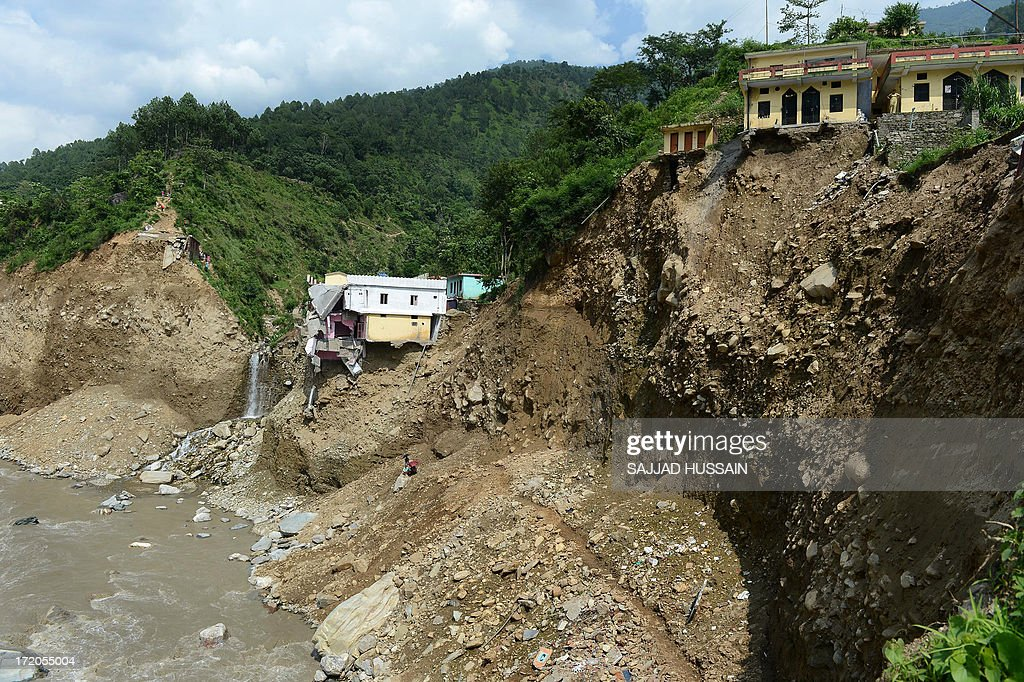 A damaged house is perched on the mountainside at Silli, in the flood affected area of northern Uttarakhand state on July 1, 2013. Construction along river banks will be banned in a devastated north Indian state amid concerns unchecked development fuelled last month's flash floods and landslides that killed thousands, the state's top official said July 1.