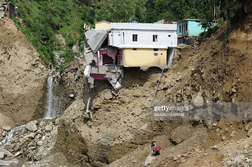 A damaged house perches on the mountainside alongside the Mandakini river at Silli, in the flood affected area of northern Uttarakhand state on July 1, 2013. Construction along river banks will be banned in a devastated north Indian state amid concerns unchecked development fuelled last month's flash floods and landslides that killed thousands, the state's top official said July 1.
