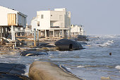 Damaged houses and the washed away 'Snad Sock' on the west end of Galveston Island almost two weeks after Hurricane Ike hit the barrier island off...