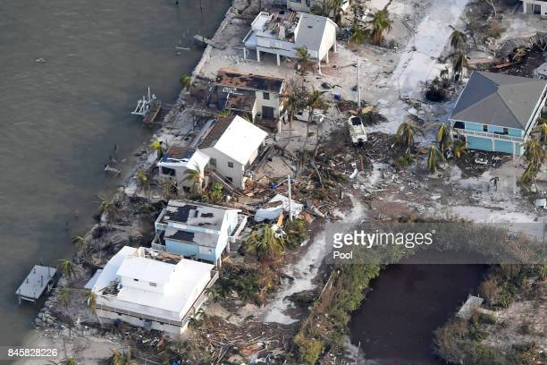 Damaged houses are seen in the aftermath of Hurricane Irma on September 11 2017 over the Florida Keys Florida
