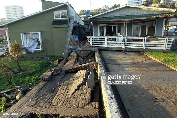 Damaged houses in Concon some 110 km northwest of Santiago on September 17 2015 hit by an earthquake on the eve A powerful 83magnitude earthquake...