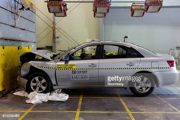 A damaged Hyundai Motor Co NF Sonata automobile stands after a crash test at the Korea Automobile Insurance Repair Research and Training Center...